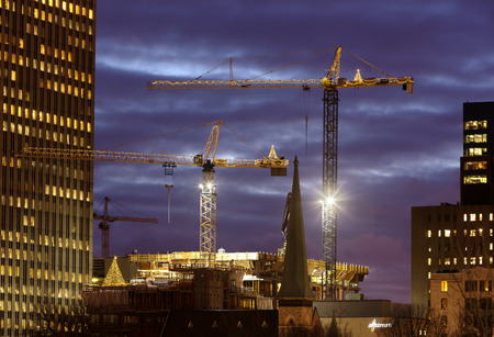 construction machinery: Tower cranes decorated with Christmas lights
