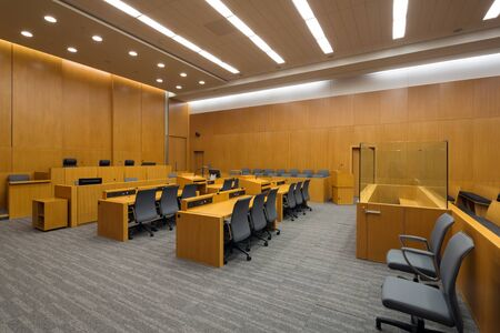 New modern courtroom viewed from the side, all setup and ready for the first case