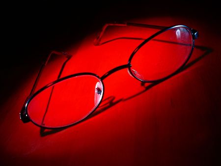Glasses on Table in Red Stock Photo