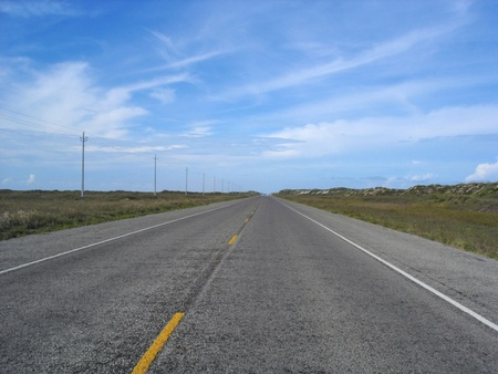 desolate: View of a desolate road stretching off into the distance.                                Stock Photo