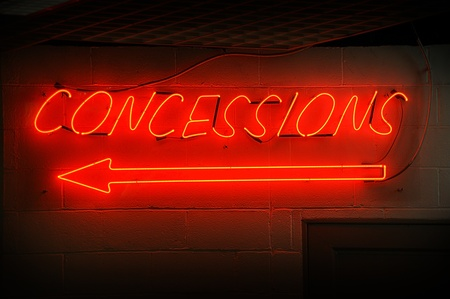 Red neon concessions signs with arrow.