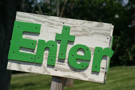 Handmade rustic outside enter sign made of wood.