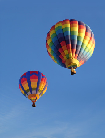 Colorful balloons against a blue sky. Portrait photo ideal for use as a cover. Stock Photo - 34726313