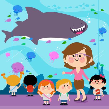 woman underwater: Students and their teacher visiting the oceanarium