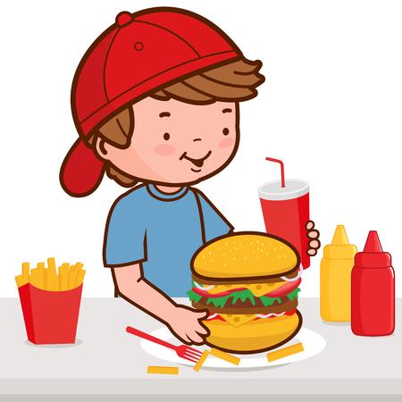 hamburger and fries: A boy having his fast food meal, eating a hamburger, fries, and drinking soda.