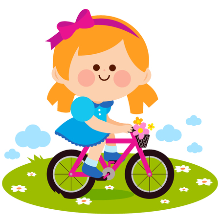 Happy little girl riding a bicycle at the park.