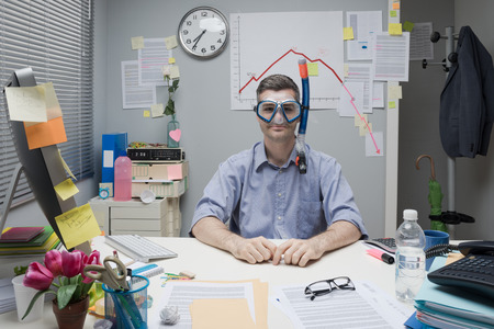 inefficient: Smiling office worker wearing scuba mask with negative business chart on background.