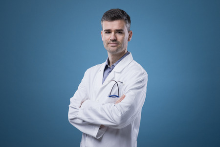 Confident smiling doctor posing with arms crossed