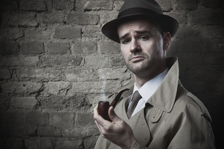 trench coat: Funny vintage investigator in trench coat holding a pipe