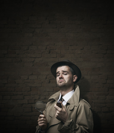 trench: Funny vintage investigator in trench coat holding a pipe