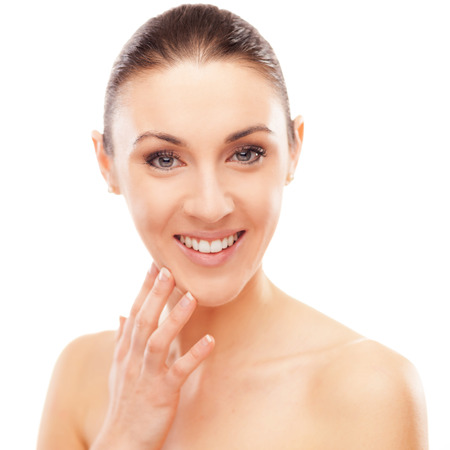 blemishes: Beautiful young woman checking her face skin and looking for blemishes