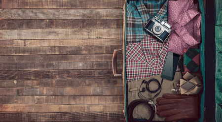 travelers: Hipster traveler vintage ready suitcase with camera and clothing, blank copy space, top view