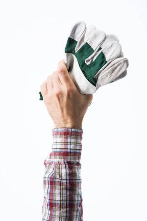 gardening gloves: Gardeners hands holding protective gardening gloves on white background Stock Photo