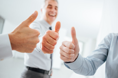 job satisfaction: Cheerful business people thumbs up, hands close up, success, achievement and satisfaction concept