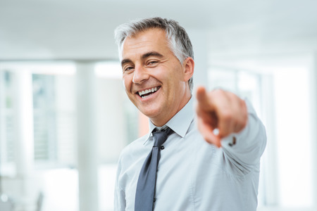 Cheerful confident businessman pointing at camera, recruitment and choice concept Stock Photo