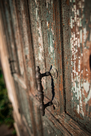 bewitched: A oldest Door with cracked paint and ancient handle