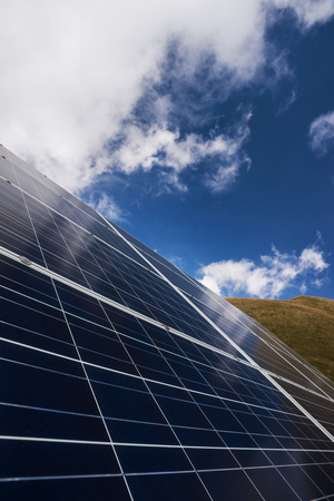 conservation: Solar panels and blue sky, electrical energy production and environmental conservation concept