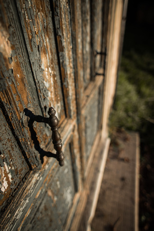 crack house: A oldest Door with cracked paint and ancient handle