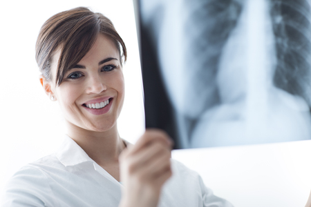 rib cage: Female doctor examining a patients x-ray of lungs and rib cage, radiology and healthcare concept
