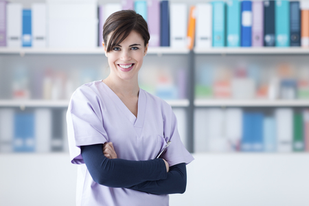 Smiling young female doctor posing with arms crossed, medical staff and healthcare concept Banco de Imagens - 52945584