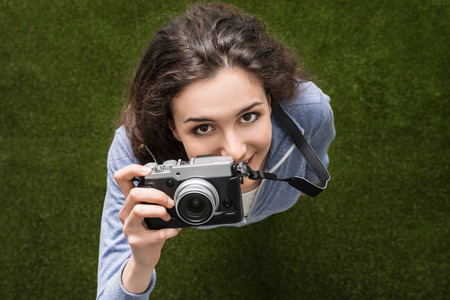 view girl: Young photographer girl shooting outdoors, hobbies and leisure concept, top view Stock Photo