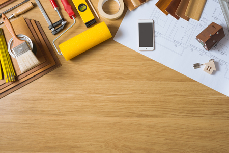 Do it yourself home remodeling and renovation concept, work table top view with copyspace and tools top view