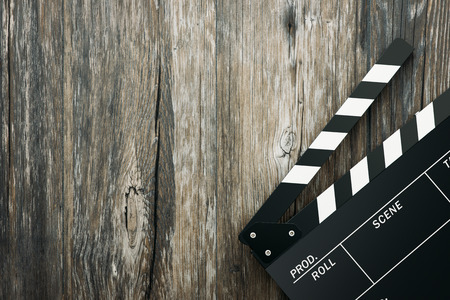 filmmaker: Clapper board on a rough wooden surface, cinema and videomaking concept