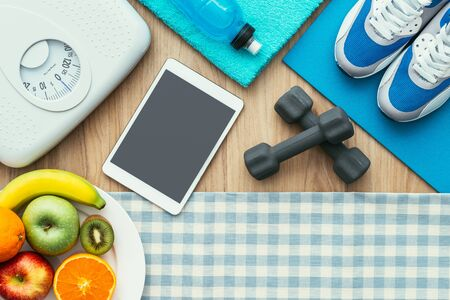 drink food: Healthy food, sports equipment, weight scale and digital tablet on a table, flat lay, healthy lifestyle and workout concept