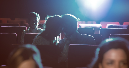 Young romantic loving couple kissing at the cinema, relationships and lifestyle concept Stok Fotoğraf
