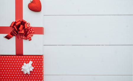 Christmas gifts with ribbons on a white wooden table, top view, blank copy space Stok Fotoğraf - 85248014