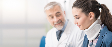 Professional doctor visiting a young patient with cervical collar at the hospital, they are talking and smiling, healthcare banner Banco de Imagens