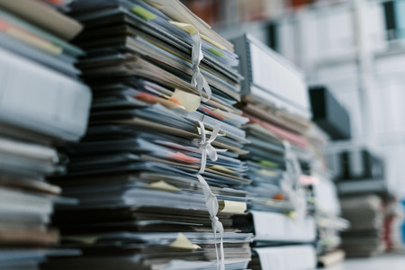 Stacks of paperwork and files in the office: work overload, files management and administration concept Banco de Imagens - 95003205