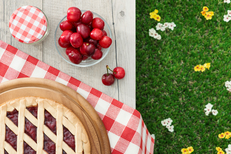 Picnic setting with tasty cherry pie and cherries, healthy eating concept
