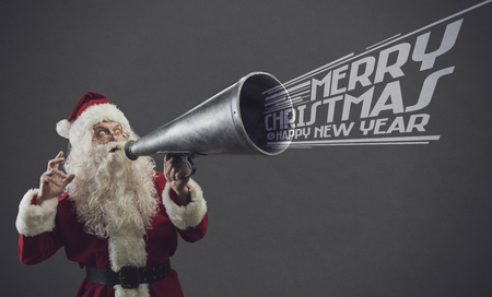 Happy Santa Claus shouting with a vintage megaphone, he is wishing you a Merry Christmas and a Happy New Year Banco de Imagens - 114191200