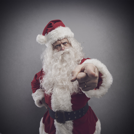Disappointed angry Santa Claus pointing his finger and reproaching you, Christmas character