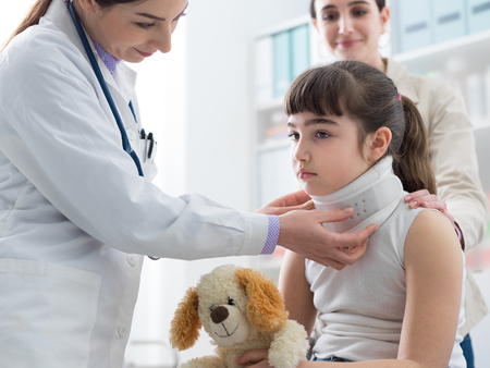 Doctor visiting a young girl with orthopedic cervical collar, first aid and treatment concept