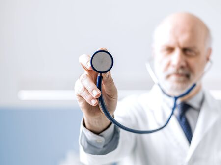 Professional doctor showing a stethoscope before a medical checkup, medicine and healthcare concept