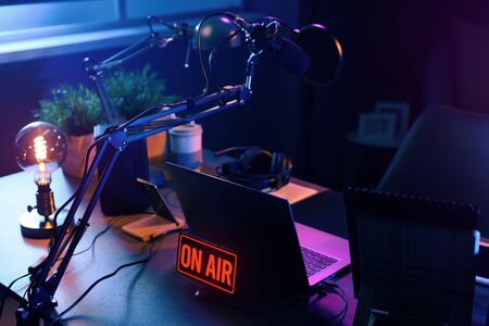 Live online radio broadcasting station desk with on air sign, entertainment and communication concept