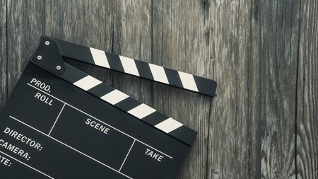 Clapper board on a rough wooden surface, cinema and videomaking concept