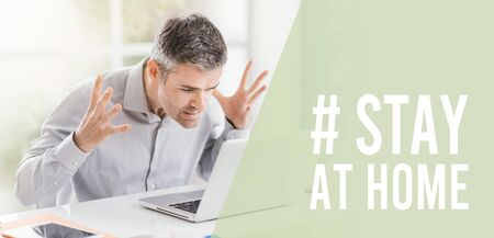 Humorous Coronavirus stay at home social media awareness campaign: stressed man working from home and shouting at the laptop