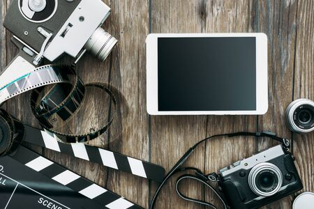 Vintage film camera, tablet, clapper board, filmstrip and old camera on a desktop, cinema and videomaking concept Stockfoto - 147806846
