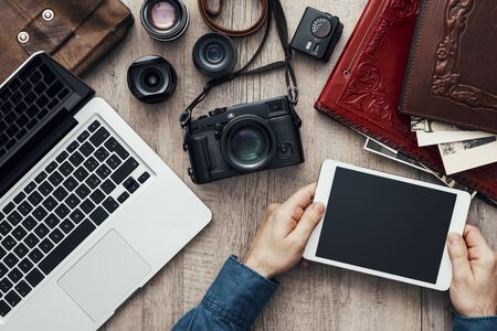 Hipster photography equipment with laptop and digital tablet on a vintage wooden desktop, flat lay 版權商用圖片