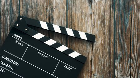 Clapper board on a rough wooden surface, cinema and videomaking concept Stockfoto - 147809549