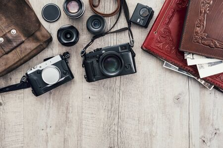 Hipster photography equipment with laptop and digital tablet on a vintage wooden desktop, flat lay Stockfoto - 147806862