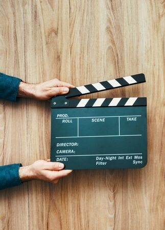 Film director holding a clapper board, filmmaking and cinema concept Stockfoto - 148582548