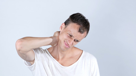 Businessman neck pain after working in the office too long time, Neckache Stock Photo