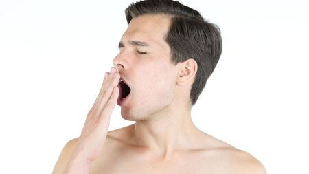 Male with lack of sleep ,a man yawning