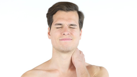desilusion: Close up of young  man with closed eyes, clenched teeth  - neck pain concept Foto de archivo