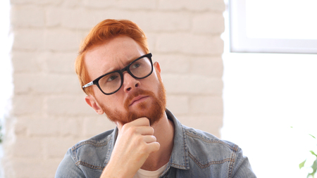 Brainstorming, Thinking Pensive Man with Beard and Red Hairs, Portrait Archivio Fotografico