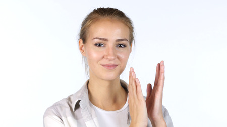 Young Female Student Clapping In Front Of White Background Stock Photo